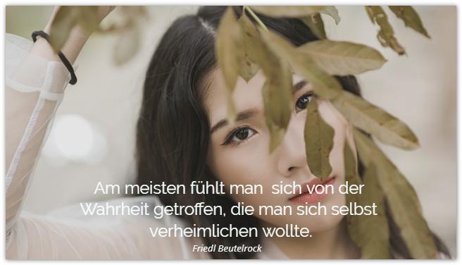 mit Enttäuschungen umgehen: junge Frau hinter Blättern
